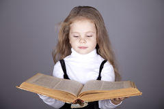 Little girl with book. Stock Photos