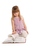 The little girl with the book Stock Photos