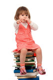 Little girl on book Royalty Free Stock Photography