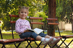 Little girl with book Royalty Free Stock Photography