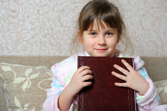 The little girl with the book Stock Photo