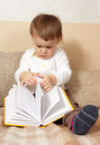 Little girl with a book Royalty Free Stock Image