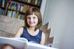 Little girl with book Royalty Free Stock Images