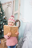 Little girl with book around the Christmas tree Royalty Free Stock Images
