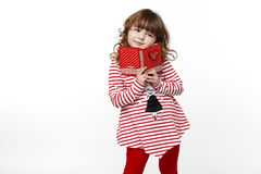 Little girl with book with heart Royalty Free Stock Image
