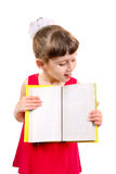 Little Girl with a Book. Little Girl with the Opened Book Isolated on the White Background Royalty Free Stock Image