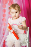 Little girl with a book in pink  skirt Royalty Free Stock Photos