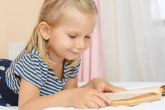 Little girl with a book Royalty Free Stock Photography