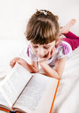 Little Girl with the Book Stock Image