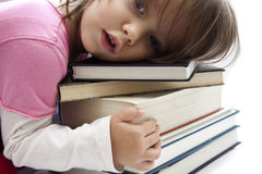 Little girl with books. Cute little girl hugging the books Stock Photos