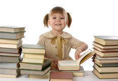 Little girl with books, back to school Stock Photos