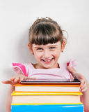 Little Girl with the Books Stock Photography