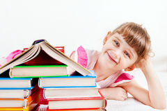 Little Girl with the Books Stock Photos