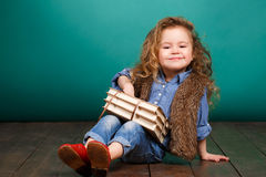Little girl with books. Royalty Free Stock Image