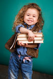 Little girl with books. Stock Images