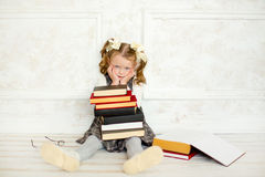 A little the girl with books Stock Photo
