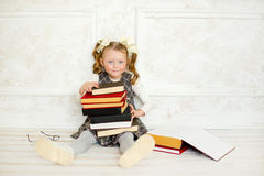 A little the girl with books Stock Photography