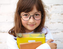 Little girl and books Royalty Free Stock Photo