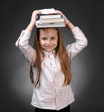 Little girl with books Royalty Free Stock Photography