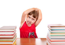 Little Girl with a Books. Naughty Little Girl with the Book at the Desk on the White Background Royalty Free Stock Photography