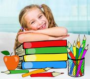 Little girl with the books royalty free stock photo