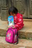 Little girl with books and small school backpack. Nepali little girl with books and small school backpack. Children, small kid portrait outside in Nepal Stock Images