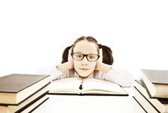 Little girl with books wearing black glasses Royalty Free Stock Photos