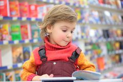 Little girl in bookshop Royalty Free Stock Images