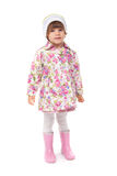 Little girl in boots and a jacket in the studio Royalty Free Stock Images
