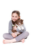 Little girl with a border collie Royalty Free Stock Image