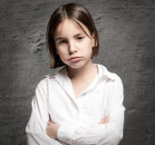 Little girl with bored expression Stock Photos