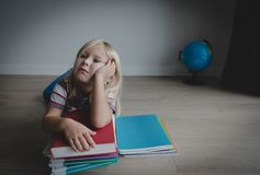 Little girl tired stressed of doing homework, bored, exhausted. Little girl bored tired exhausted stressed of doing homework and learning stock photo