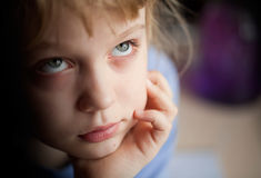 Little girl is boring and misses Stock Photography