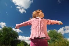Little girl from  bottom view outdoor Stock Images