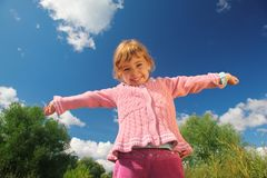 Little girl from  bottom view outdoor Royalty Free Stock Photo