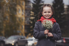 The little girl with a bouquet Stock Photography