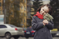 The little girl with a bouquet Stock Image