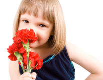 Little girl with a bouquet of carnations Royalty Free Stock Image