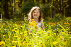 Little girl with a bouquet of dandelions Royalty Free Stock Photo