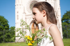 Little girl with the bouquet of the field flowers Royalty Free Stock Photos