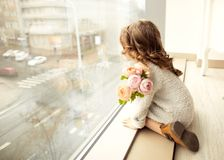 A little girl with a bouquet of flowers on her mother`s day sit Royalty Free Stock Photography