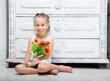 Little girl with a bouquet of flowers Stock Photos