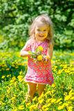 Little girl with bouquet in the park Stock Images
