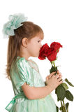 The little girl with a bouquet of roses Stock Images