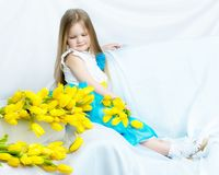 Little girl with bouquet of tulips stock photos