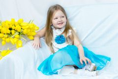 Little girl with bouquet of tulips royalty free stock photo