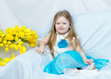 Little girl with bouquet of tulips Stock Photography