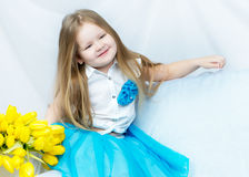 Little girl with bouquet of tulips Royalty Free Stock Photography