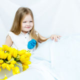 Little girl with bouquet of tulips Royalty Free Stock Photos