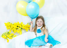 Little girl with bouquet of tulips royalty free stock image